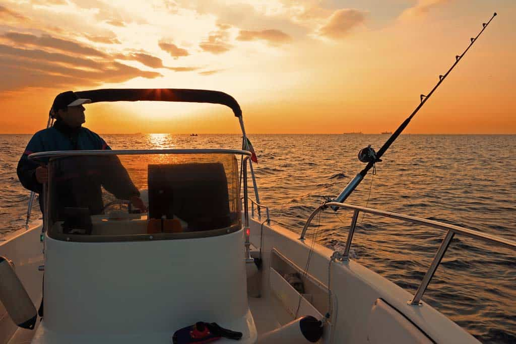 fishing for bass in my boat early in the morning sunset